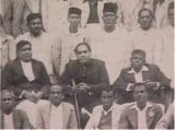 Dr. Ambedkar with prominent social workers of the Independent Labour Party at Bombay in 1936. Seen in the second row (seated) are Mr. R. R. Bole, Afdvocate Gadkari. Dr. Ambedkar, Nanasaheb Tipins of Mahad. Behid them are Mr. Ganpat Mahadev Jadhav (in cap) and on his left is Mr. Ramakrishna Bhatankar, the then MLA of Bombay Legislative Assembly